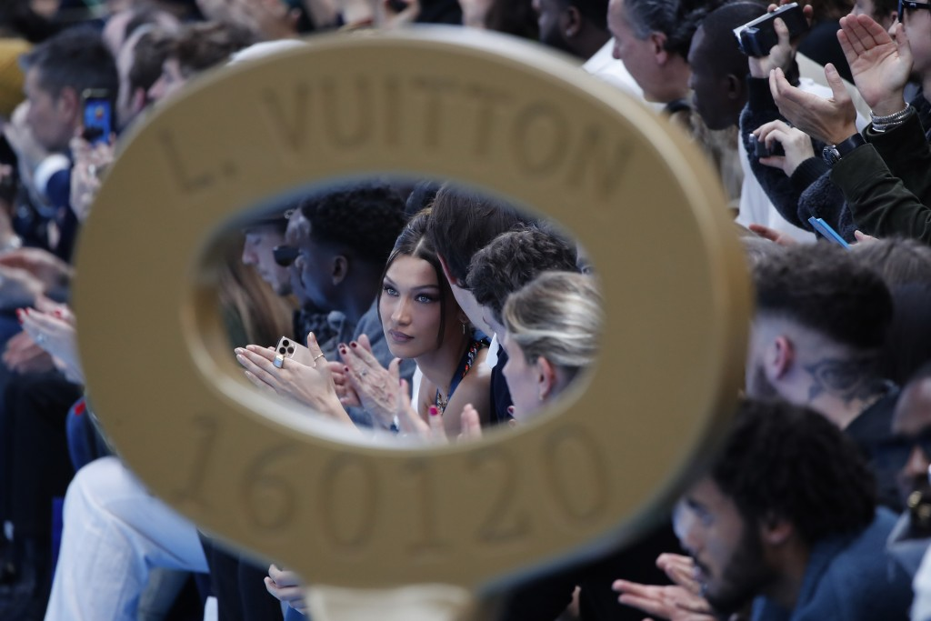 CAPTION CORRECTS THE SEASON -Model Bella Hadid watches the Vuitton Mens Fall/Winter 2020-2021 fashion collection presented in Paris, Thursday Jan. 16,...