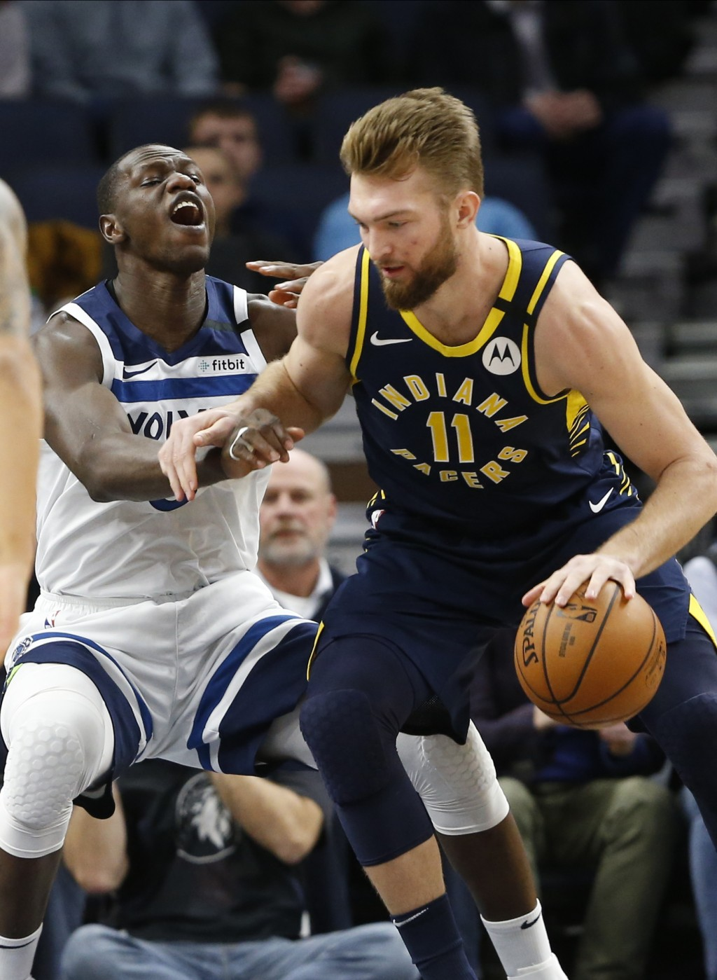 Indiana Pacers' Domantas Sabonis, right, of Lithuania, drives around Minnesota Timberwolves' Gorgui Dieng of Senegal in the first half of an NBA baske...