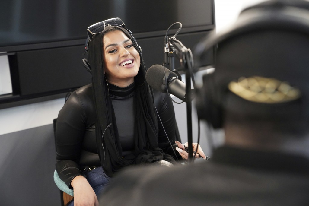 In this Dec. 19, 2019, photo, Amani Al-Khatahtbeh, founder of Muslimgirl.com, records a podcast pilot at Spotify's headquarters in New York. On her si...