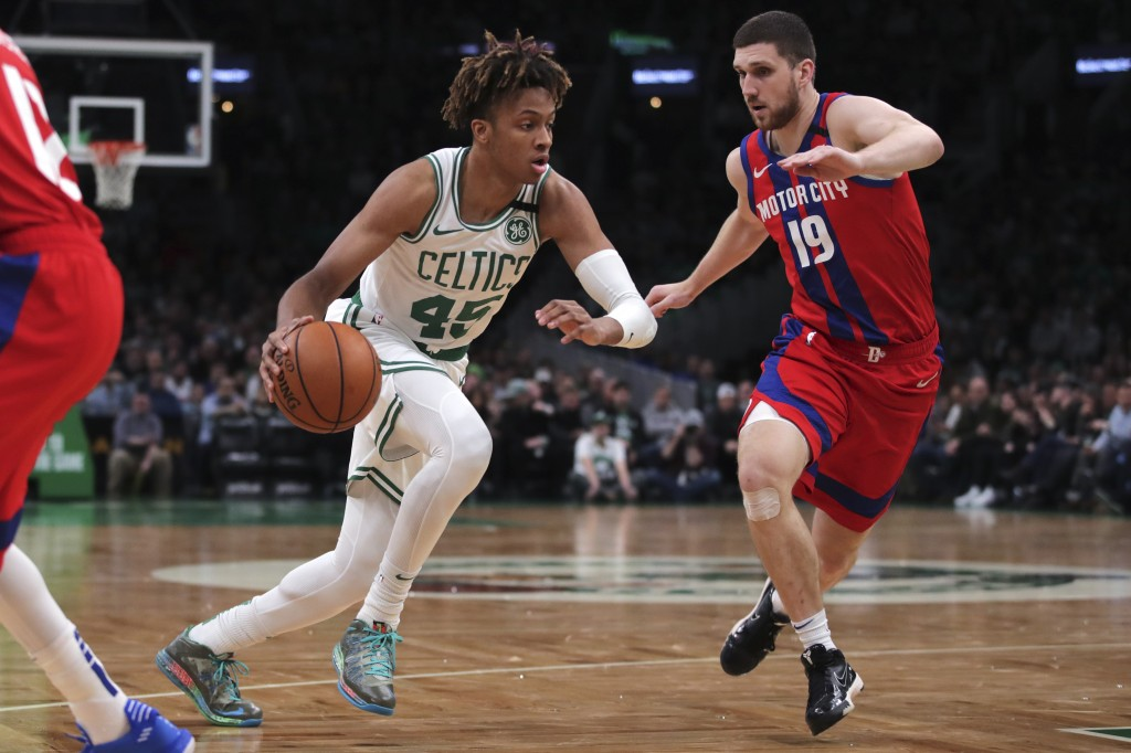 Boston Celtics guard Romeo Langford (45) drives to the basket as Detroit Pistons guard Sviatoslav Mykhailiuk (19) defends during the first half of an ...