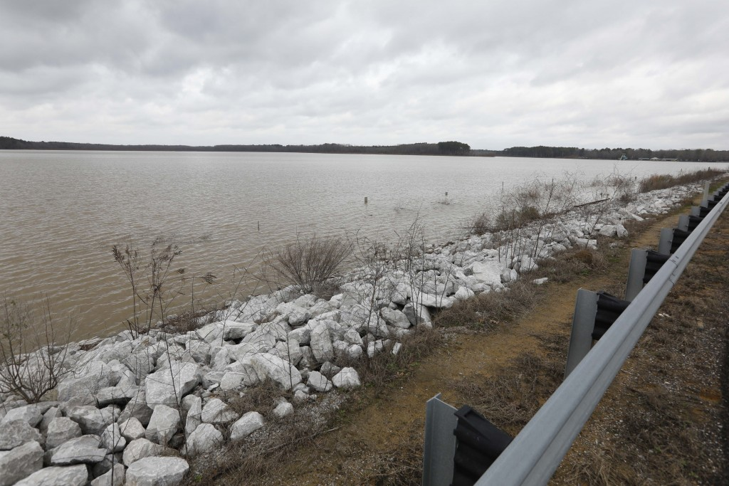 Darkening skies surround the Oktibbeha County Lake near Starkville, Miss., Wednesday, Jan. 15, 2020. The rain-swollen lake is keeping heavy pressure o...