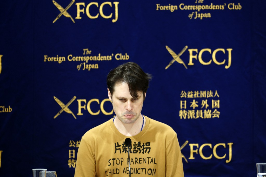 Tokyo-based Australian journalist Scott McIntyre speaks during a press conference at the Foreign Correspondent's Club Japan in Tokyo Thursday, Jan. 16...