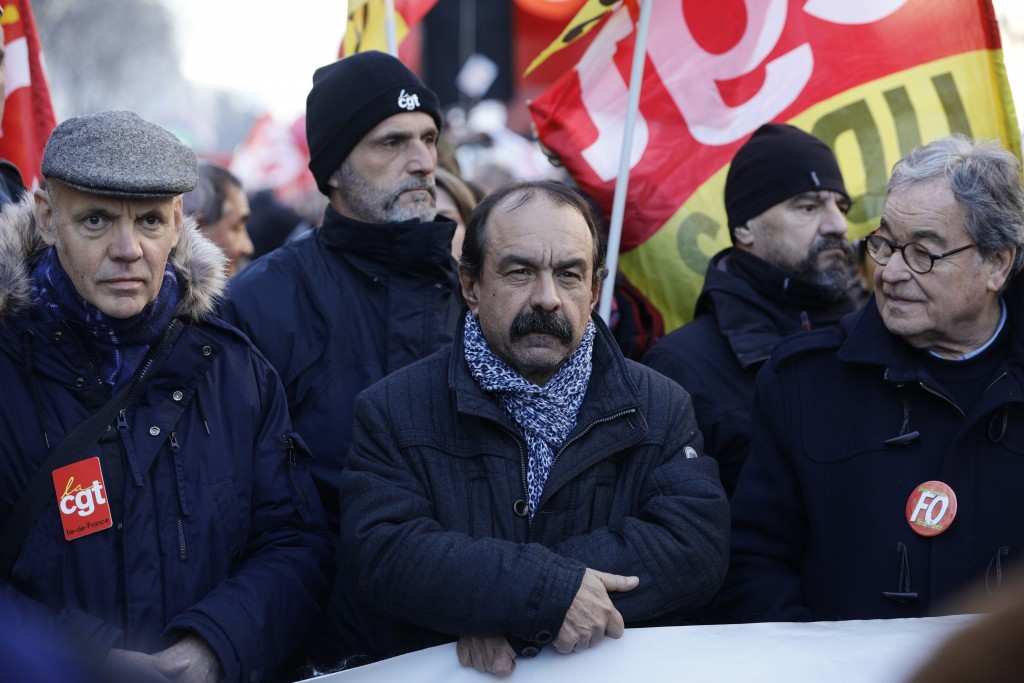 CGT union leader Philippe Martinez, center, attends a demonstration Thursday, Jan. 16, 2020 in Paris. Protesters denounce French President Emmanuel Ma...