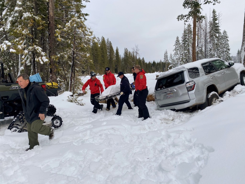 In this photo provided by the Butte County Sheriff's Department, members of the Butte County Sheriff's Search and Rescue team transport 68-year-old Pa...
