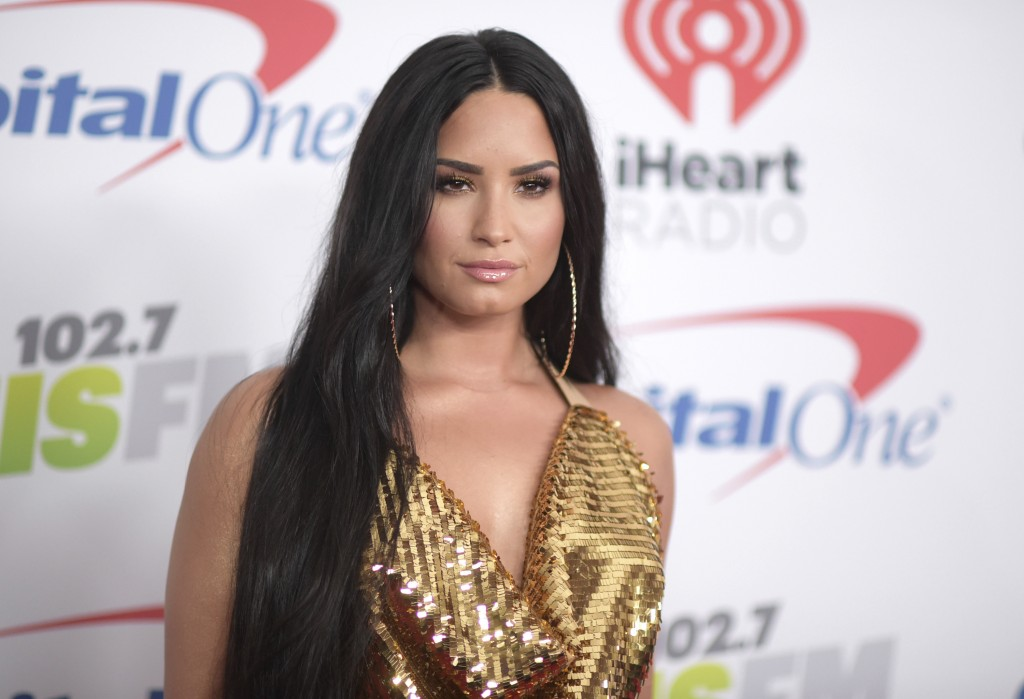 FILE - In this Dec. 1, 2017 file photo, Demi Lovato arrives at Jingle Ball at The Forum in Inglewood, Calif. Lovato will perform the National Anthem a...