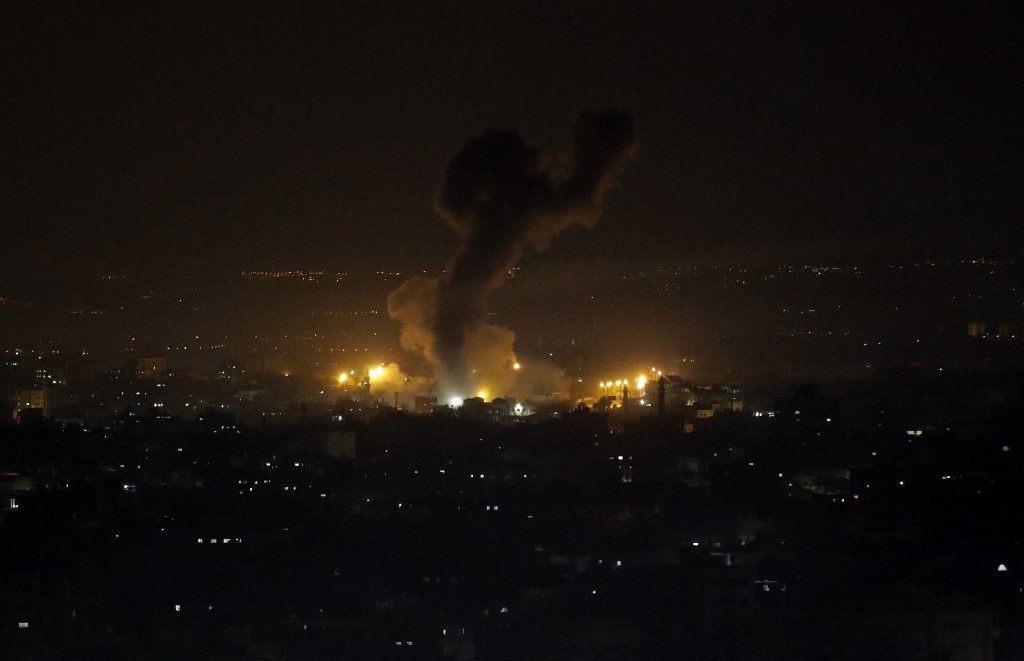 An explosion caused by Israeli airstrikes is seen on Gaza City, Wednesday, Jan. 15, 2020. Israel reportedly targeted several Hamas military sites in t...