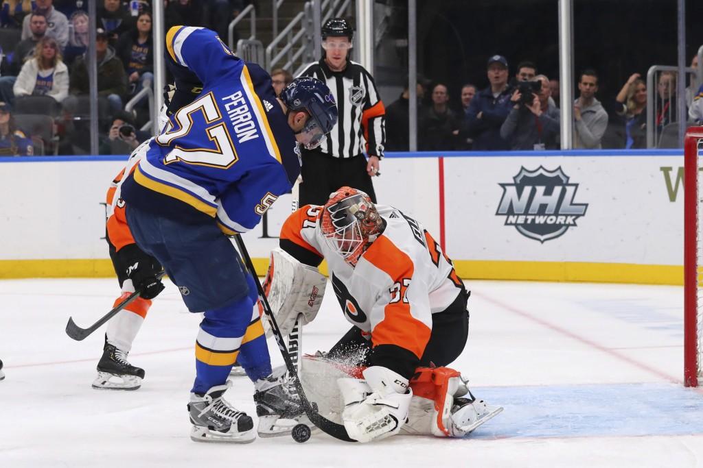 Philadelphia Flyers goalie Brian Elliott (37) makes a save against St. Louis Blues forward David Perron (57) during the second period of an NHL hockey...