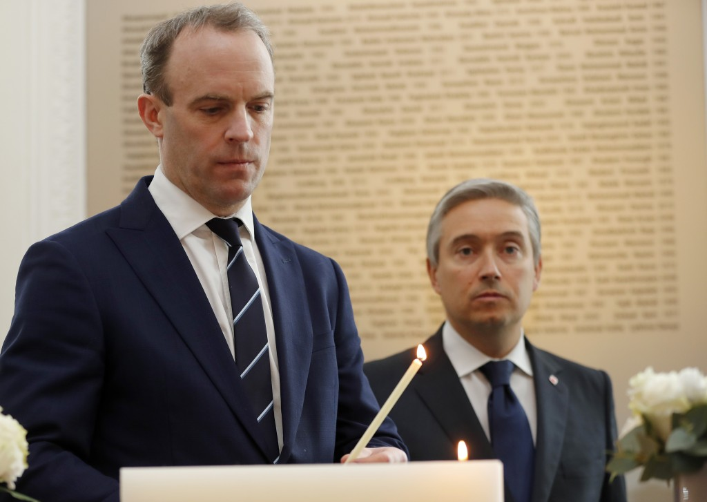 Francois-Philippe Champagne, Canada Minister of Foreign Affairs, right, UK's Secretary of State for Foreign Affair Dominic Raab light a candle in fron...