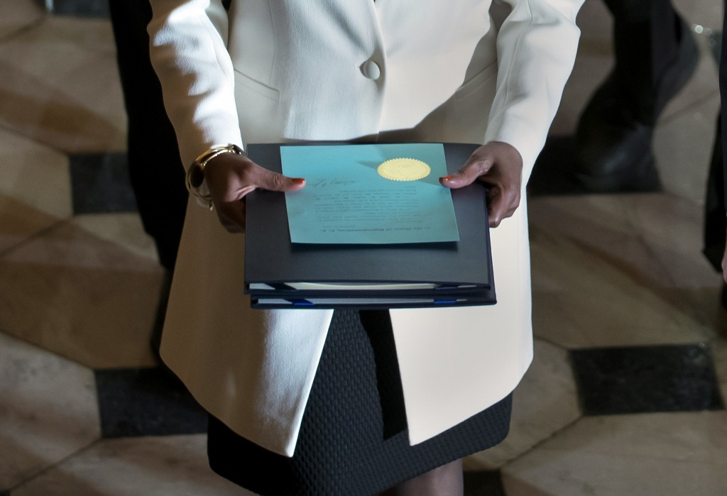 Clerk of the House Cheryl Johnson carries the articles of impeachment against President Donald Trump to the Senate, on Capitol Hill in Washington, Wed...