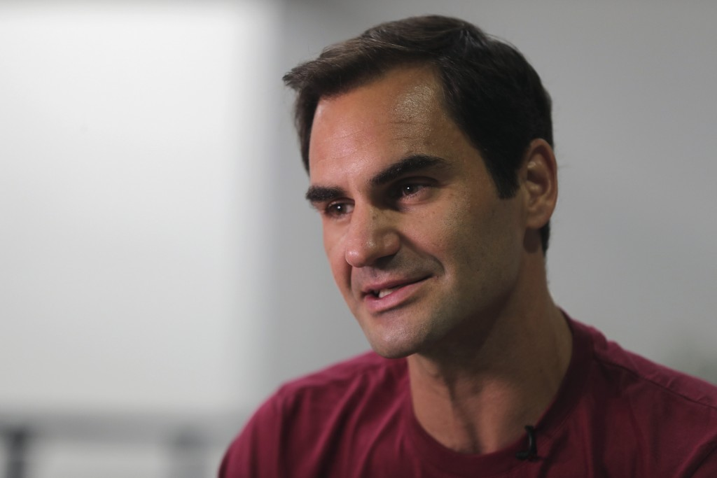 FILE - In this Sunday, Dec. 15, 2019, file photo, Roger Federer talks to an Associated Press reporter in Dubai, United Arab Emirates. Federer figures ...