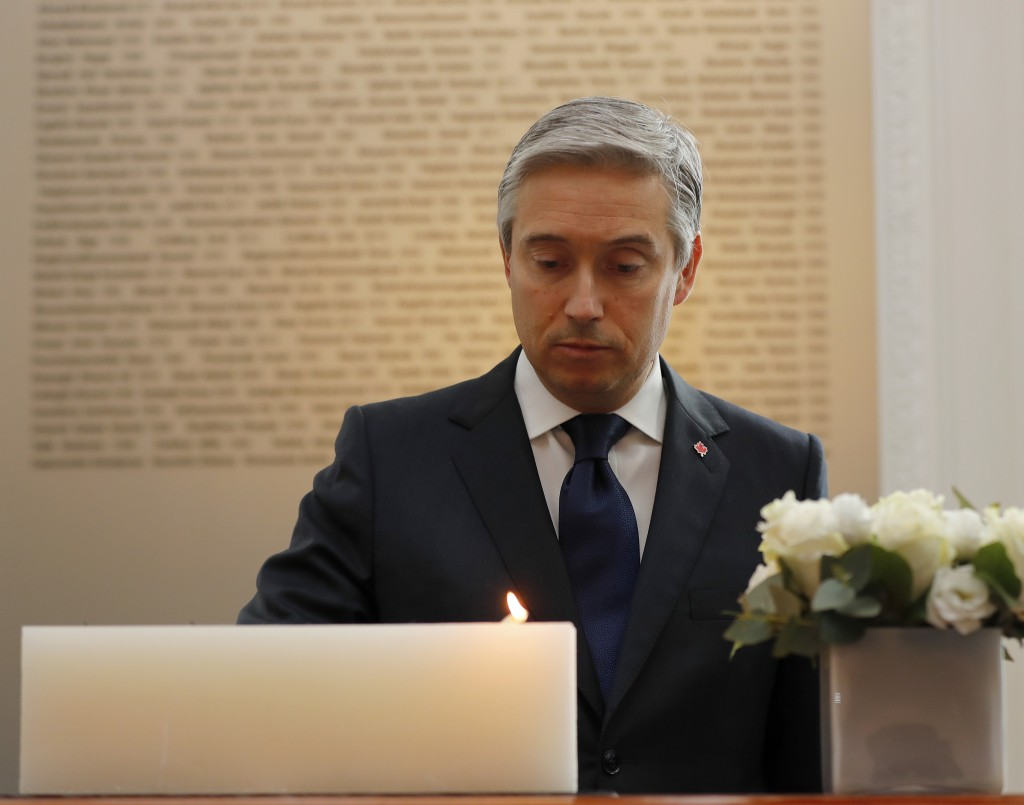 François-Philippe Champagne, Canada Minister of Foreign Affairs lights a candle in front of a plaque with the names of the victims of flight PS752, at...