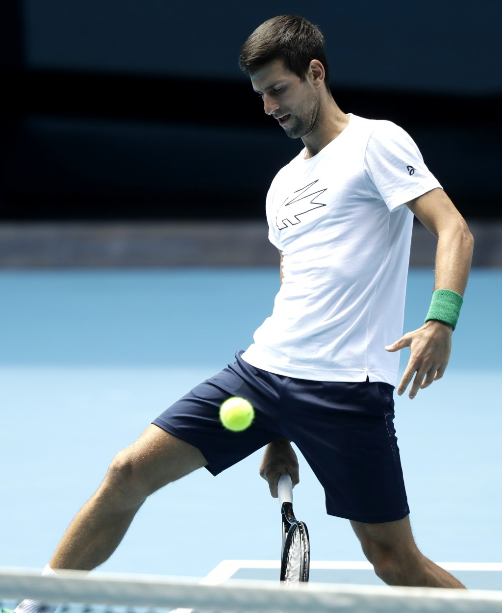 Serbia's Novak Djokovic hits the ball during a practice session on Rod laver Arena ahead of the Australian Open tennis championship in Melbourne, Aust...