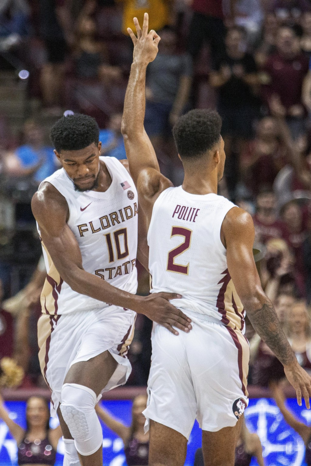 Florida State forward Malik Osborne (10) congratulates guard Anthony Polite (2) after a 3-point shot during the first half of the team's NCAA college ...