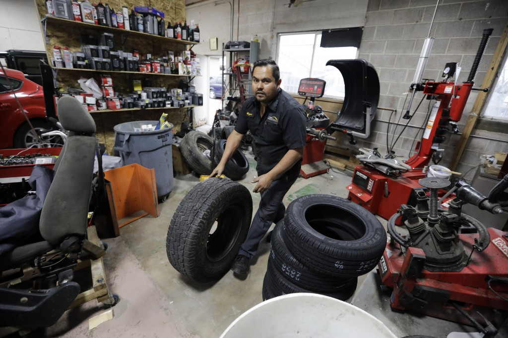 In this Nov. 22, 2019, photo, mechanic Miguel Borrayo works on a car in Ogden, Utah. Borrayo tried to find a lawyer to help him argue he should be all...