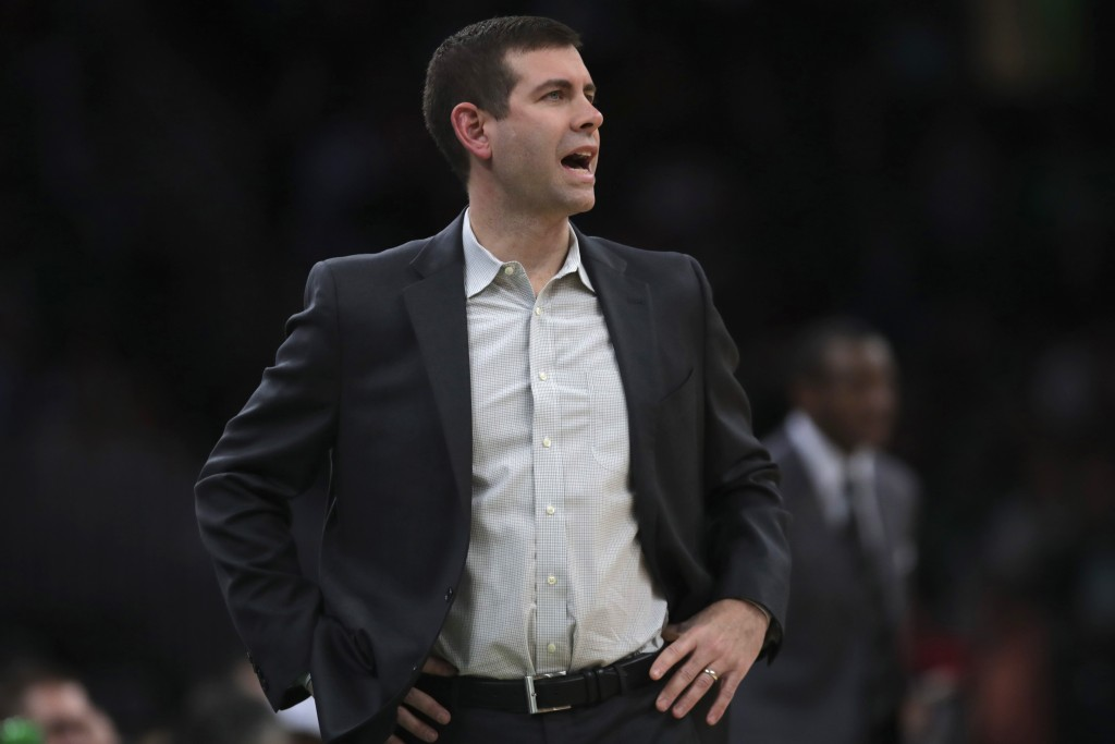 Boston Celtics coach Brad Stevens calls to his players during the first half of an NBA basketball game against the Detroit Pistons in Boston, Wednesda...