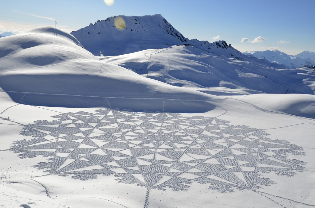 In this 2014 photo, provided by Simon Beck Snow Art, is one of Beck's pieces in the snow at the Les Arcs ski resort in southeastern France. Using a co...