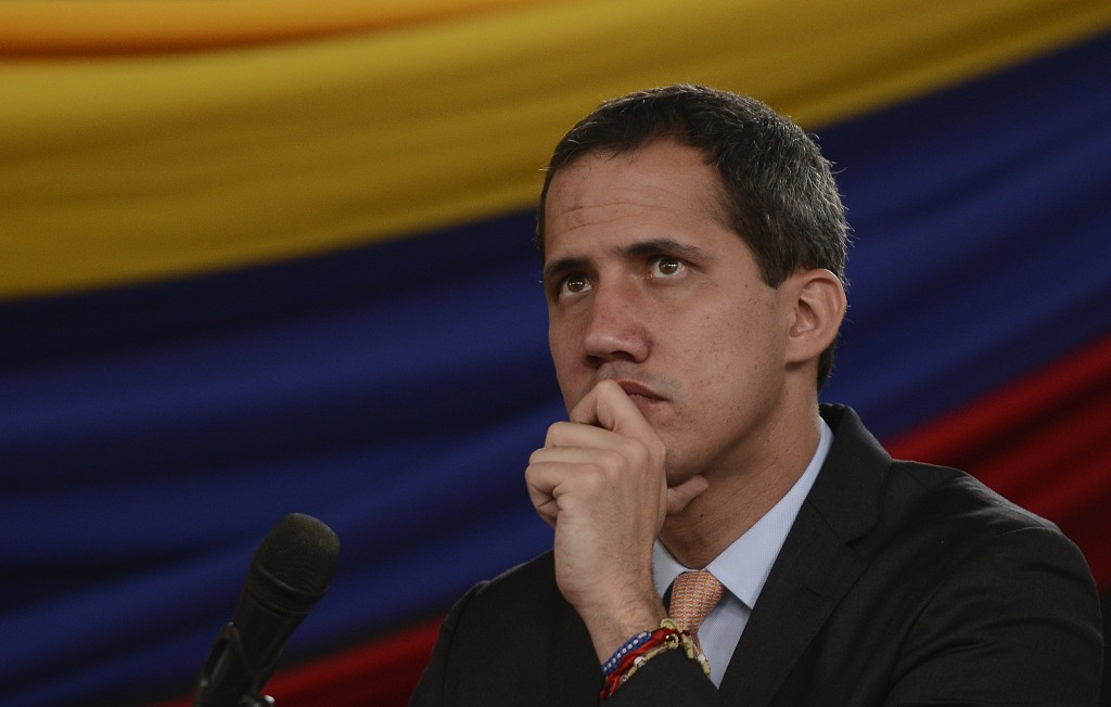 Opposition leader Juan Guaido holds a session at a theater in the El Hatillo neighborhood after opposition lawmakers' vehicles were attacked by govern...