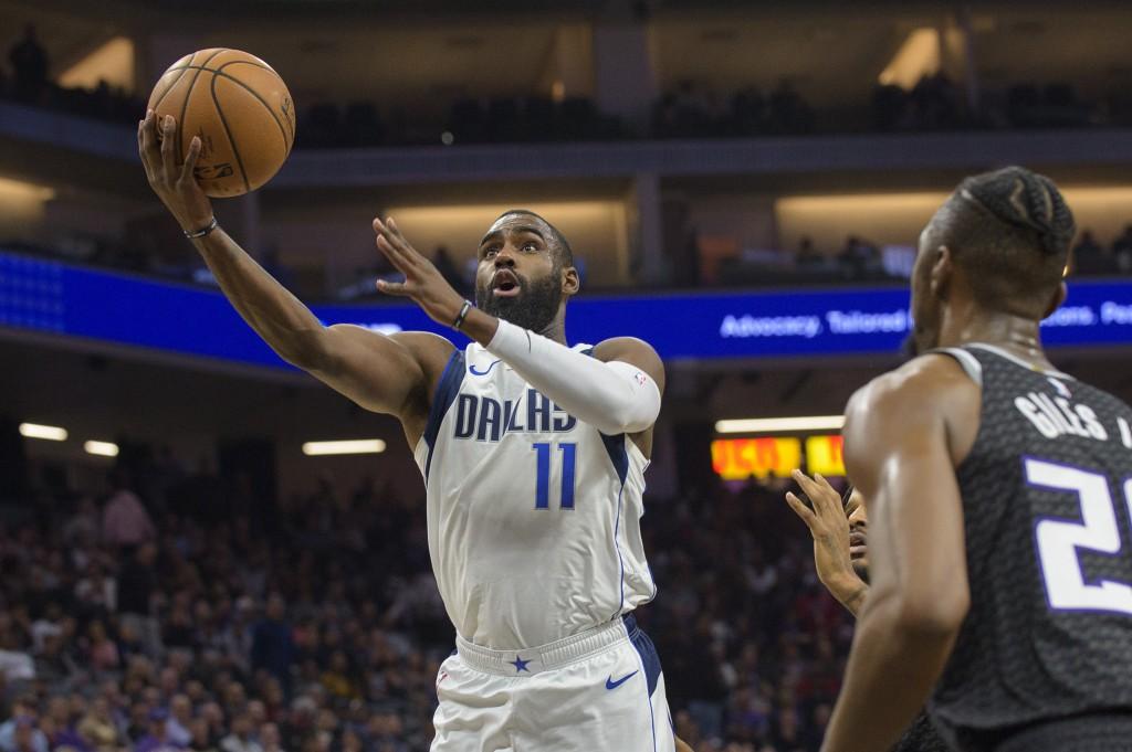 Dallas Mavericks guard Tim Hardaway Jr. (11) lays the ball up over Sacramento Kings forward Harry Giles III (20) during the first quarter of an NBA ba...