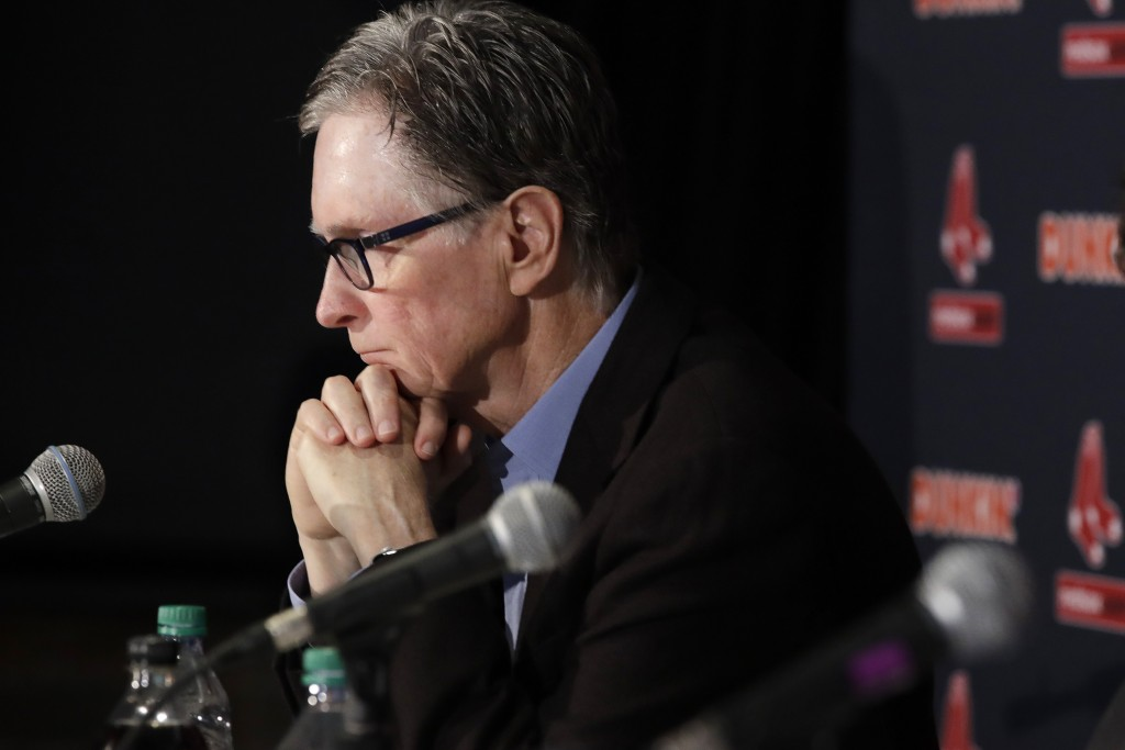 Boston Red Sox baseball team owner John Henry listens during a news conference at Fenway Park, Wednesday, Jan. 15, 2020, in Boston. The Boston Red Sox...