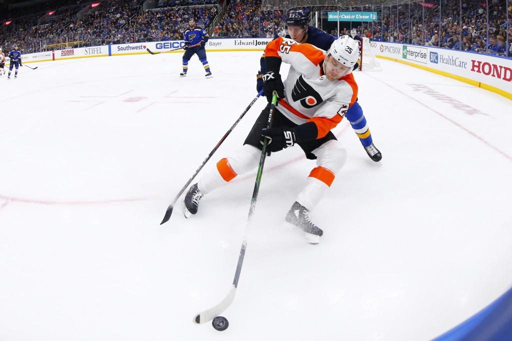 Philadelphia Flyers forward James van Riemsdyk (25) beats St. Louis Blues defenseman Niko Mikkola (77) of Finland to the puck during the first period ...