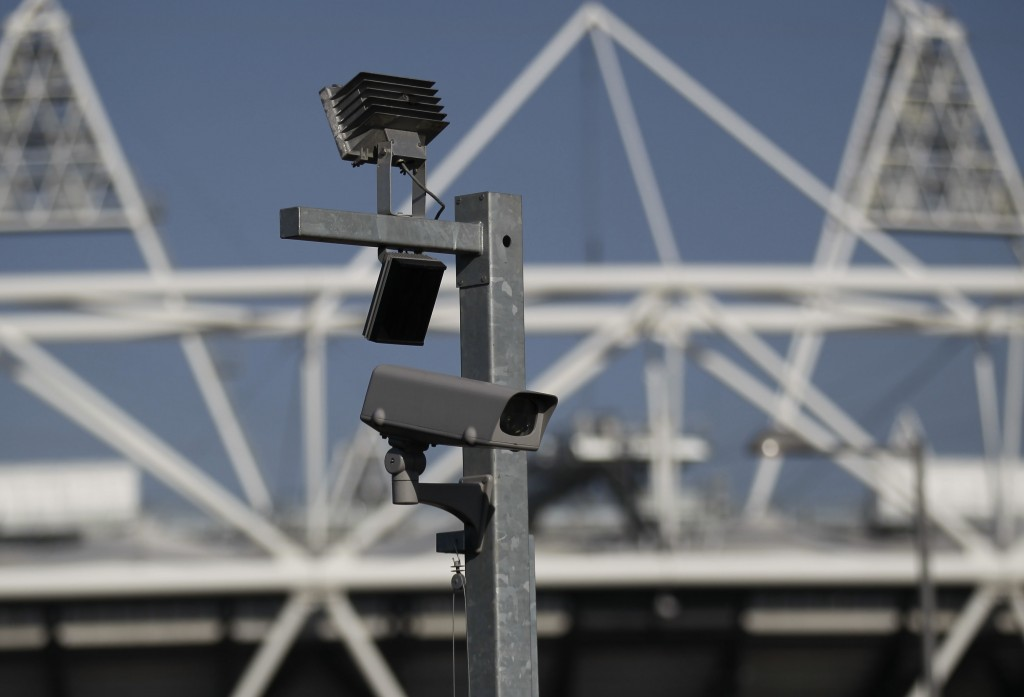 FILE - In this file photo dated Wednesday, March 28, 2012, a security cctv camera is seen by the Olympic Stadium at the Olympic Park in London.  The S...