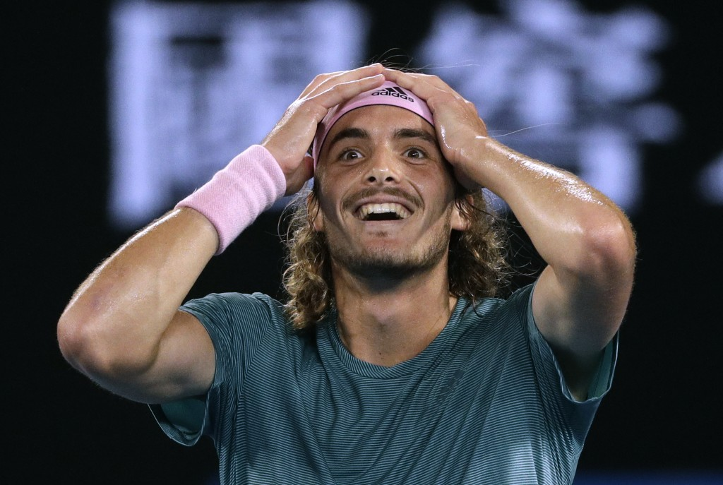 FILE  - In this Jan. 20, 2019, file photo, Greece's Stefanos Tsitsipas celebrates after defeating Switzerland's Roger Federer in their fourth round ma...