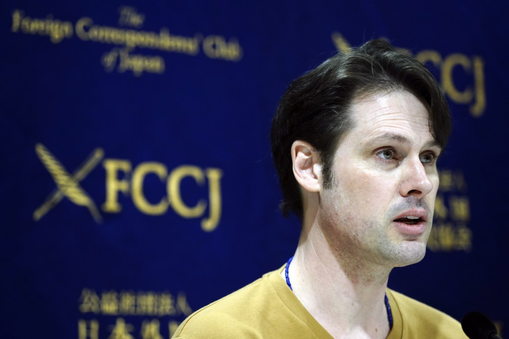 Tokyo-based Australian journalist Scott McIntyre speaks during a press conference at Foreign Correspondent's Club Japan in Tokyo Thursday, Jan. 16, 20...