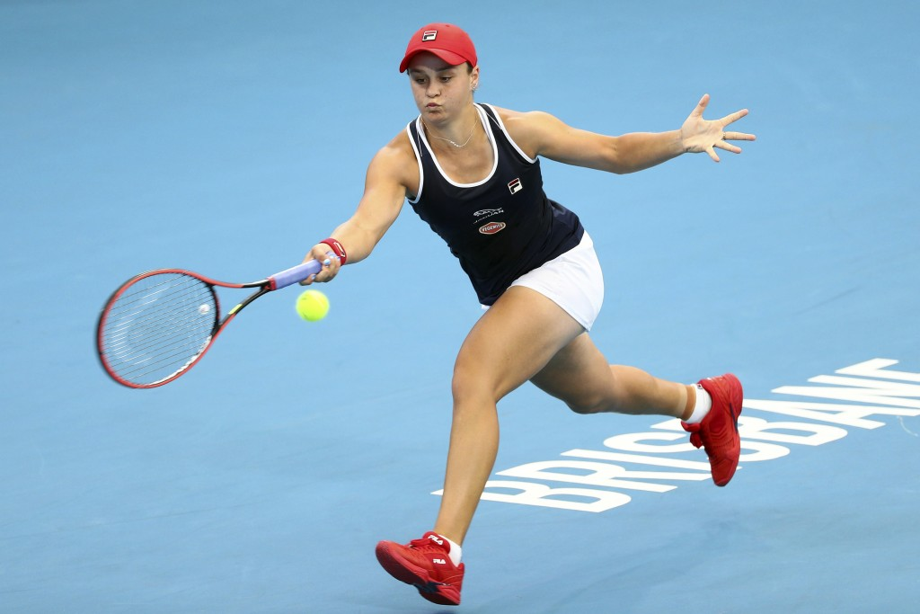 FILE - In this Jan. 9, 2020, file photo, Ashleigh Barty, of Australia, plays a shot during her match against Jennifer Brady, of the United States, at ...