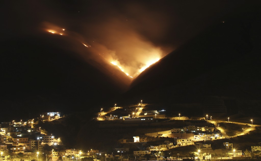 A wildfire burns on Casitagua hill, north of Quito, Ecuador, Wednesday, Jan. 15, 2020. While the fire is not threatening homes, the smoke is reaching ...