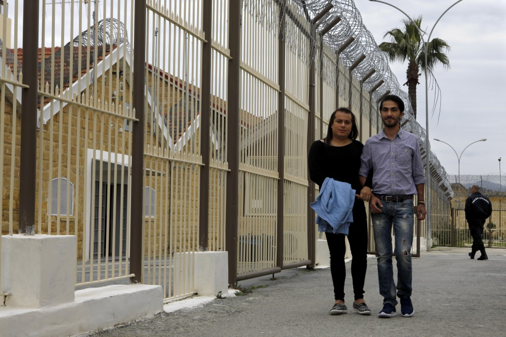 Cypriot Kevork Tontian, right, and Brazilian Wemson Gabral da Costa walk together inside Cyprus' prison in the capital Nicosia, Cyprus, Thursday, Jan....