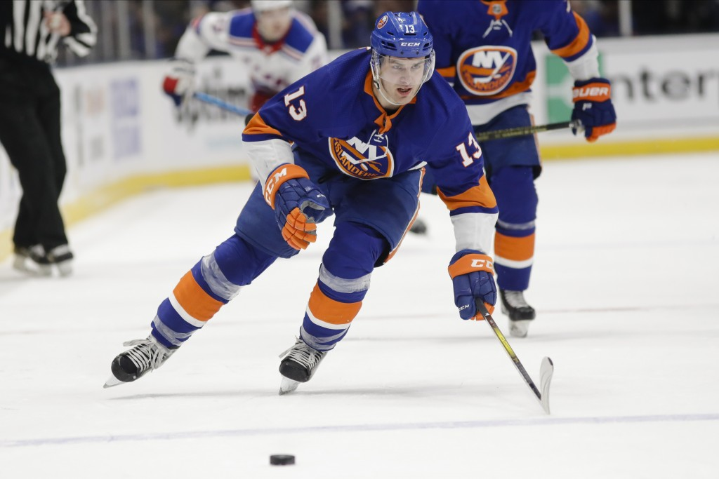 New York Islanders' Mathew Barzal (13) chases down the puck during the second period of an NHL hockey game against the New York Rangers Thursday, Jan....