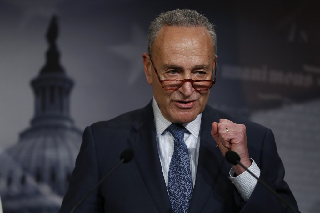 Senate Minority Leader Chuck Schumer, D-N.Y., talks to reporters about the impeachment trial of President Donald Trump on charges of abuse of power an...