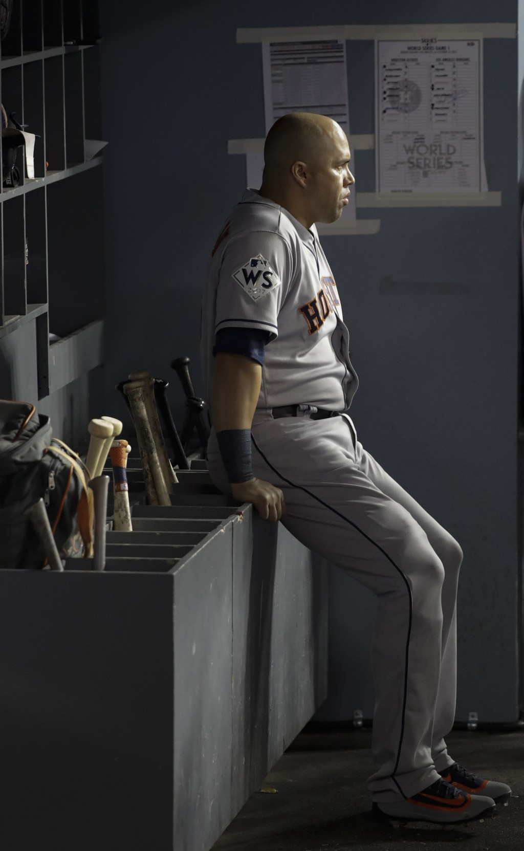 FILE - In this Oct. 24, 2017, file photo, then-Houston Astros' Carlos Beltran waits in the dugout during the sixth inning of Game 1 of baseball's Worl...