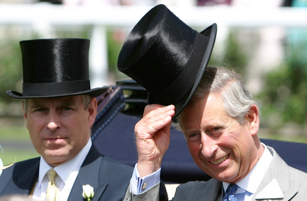 FILE - In this Wednesday June 21, 2006 file photo, Britain's Prince Charles, right with is brother the Prince Andrew the Duke of York as they arrive i...