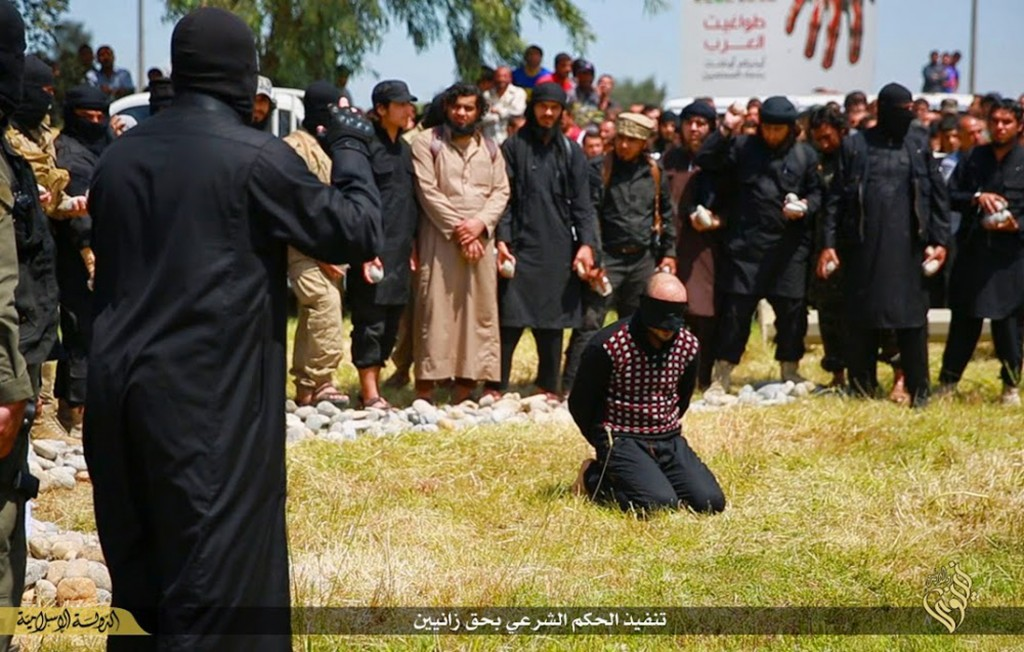 In this photo released on April 27, 2015, by a militant website, which has been verified and is consistent with other AP reporting, Islamic State mili...