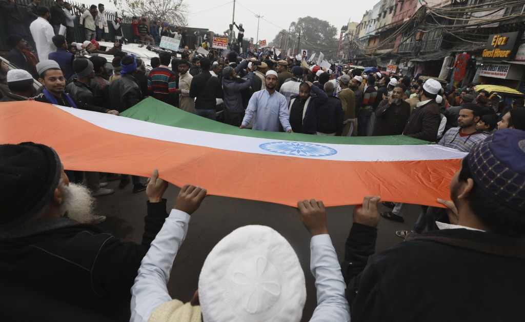Indian Muslims carry a national flag during a protest against a new Citizenship law, after Friday prayers in New Delhi, India, Friday, Jan. 17, 2020. ...