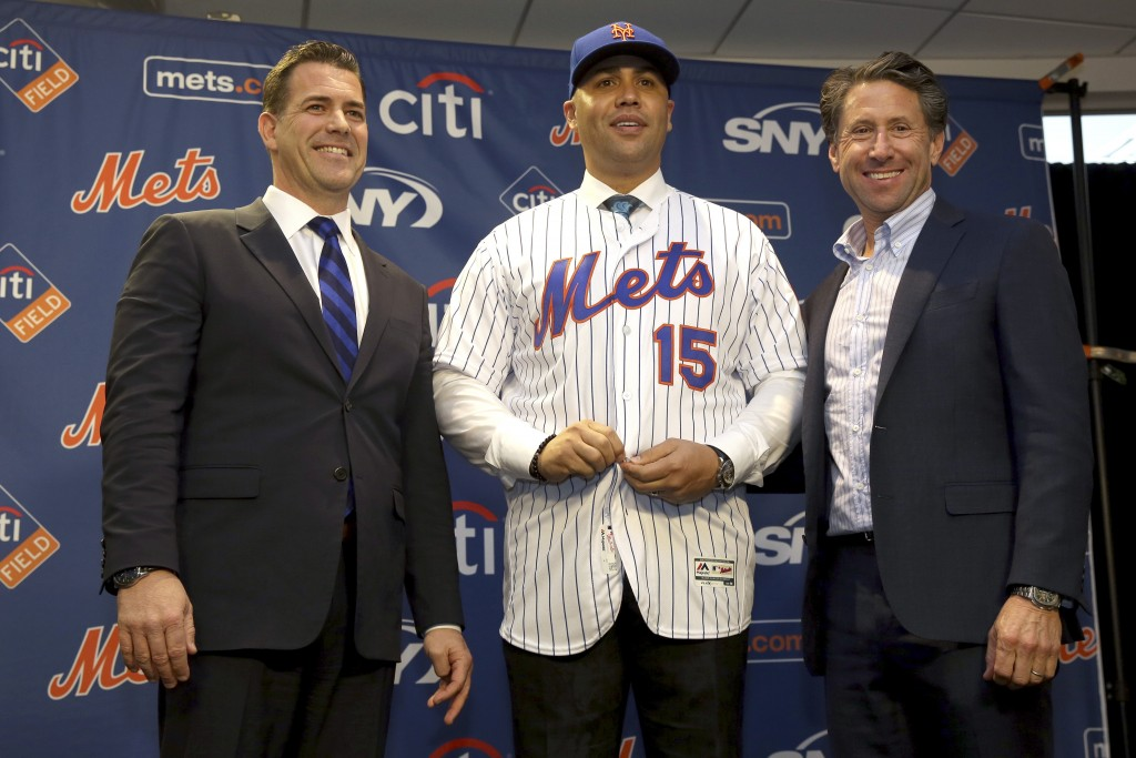FILE - In this Nov. 4, 2019, file photo, new New York Mets manager, Carlos Beltran, center, poses for a picture with general manager Brodie Van Wagene...