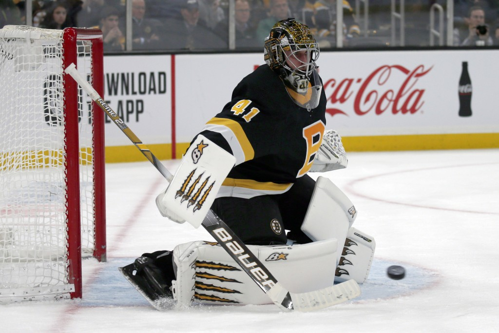 Boston Bruins goaltender Jaroslav Halak (41) makes a pad save during the third period of an NHL hockey game against the Pittsburgh Penguins, Thursday,...