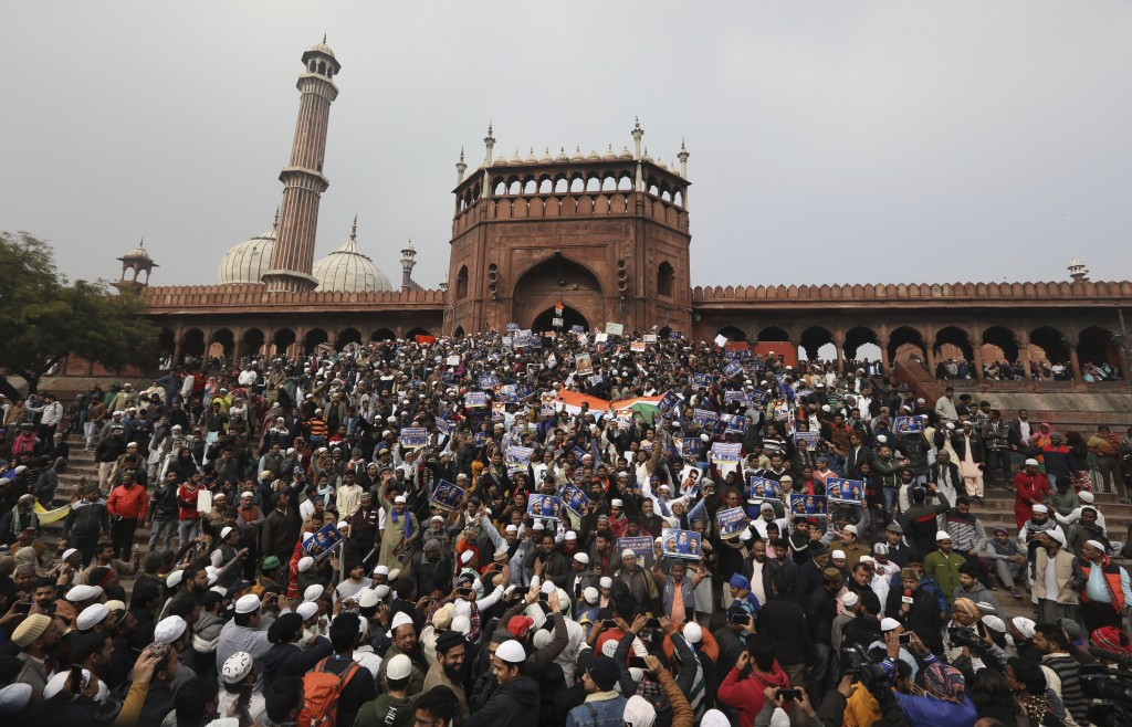 Indian Muslims along with activists of Bhim Army shout slogans against a new Citizenship law, after Friday prayers in New Delhi, India, Friday, Jan. 1...