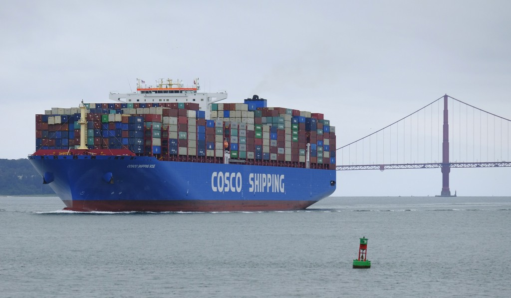 FILE - In this May 14, 2019 file photo, a Cosco Shipping container ship passes the Golden Gate Bridge in San Francisco bound for the Port of Oakland. ...
