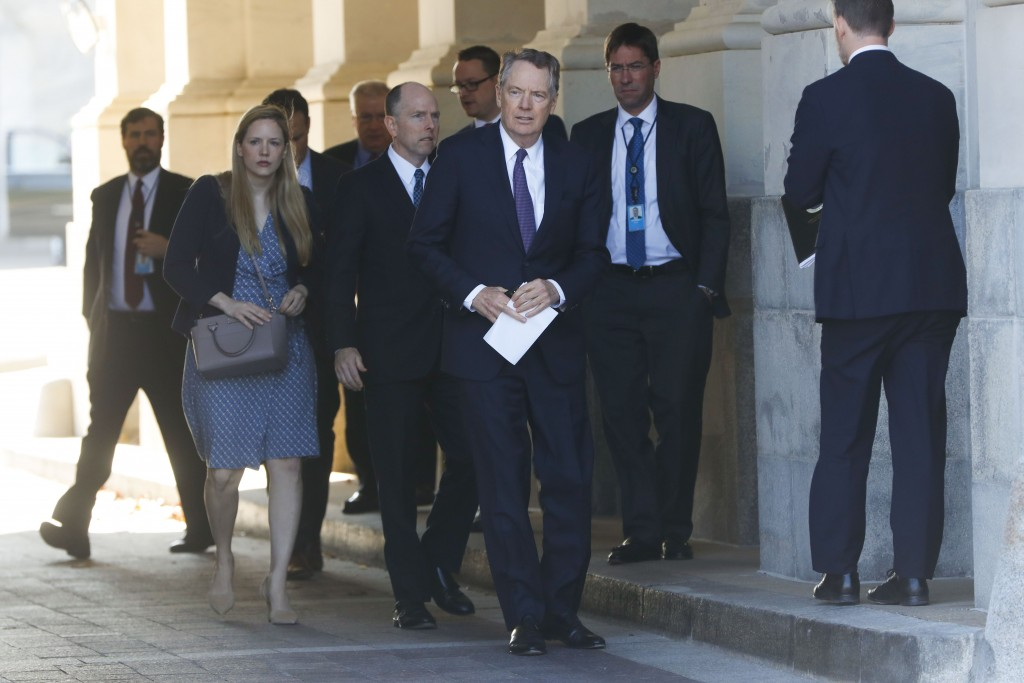 U.S. Trade Representative Robert Lighthizer, center, and members of his staff leave the U.S. Capitol, Thursday, Jan. 16, 2020. Earlier the Senate over...