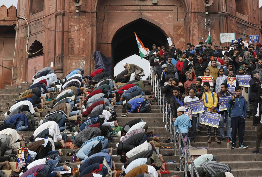 Indian Muslims offer prayers, as activists of Bhim Army wait for the start of a protest against a new Citizenship law, in New Delhi, India, Friday, Ja...