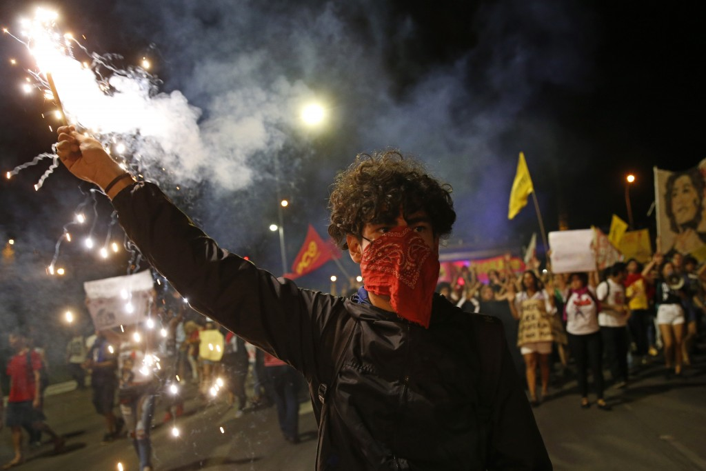 Demonstrator march against a bus fare increase in Brasilia, Brazil, Tuesday, Jan. 14, 2020. Protests sparked after a bus fare hike of almost 10 percen...