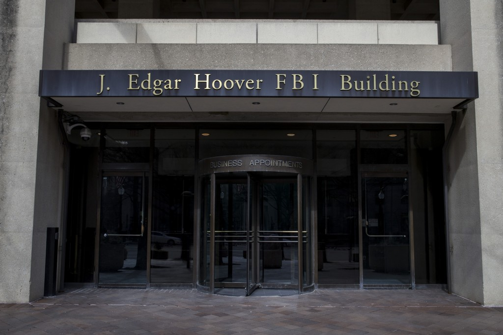 FILE - In this March 4, 2019, file photo, the J. Edgar Hoover FBI Building is seen in Washington. The FBI, in a change of policy, is committing to inf...
