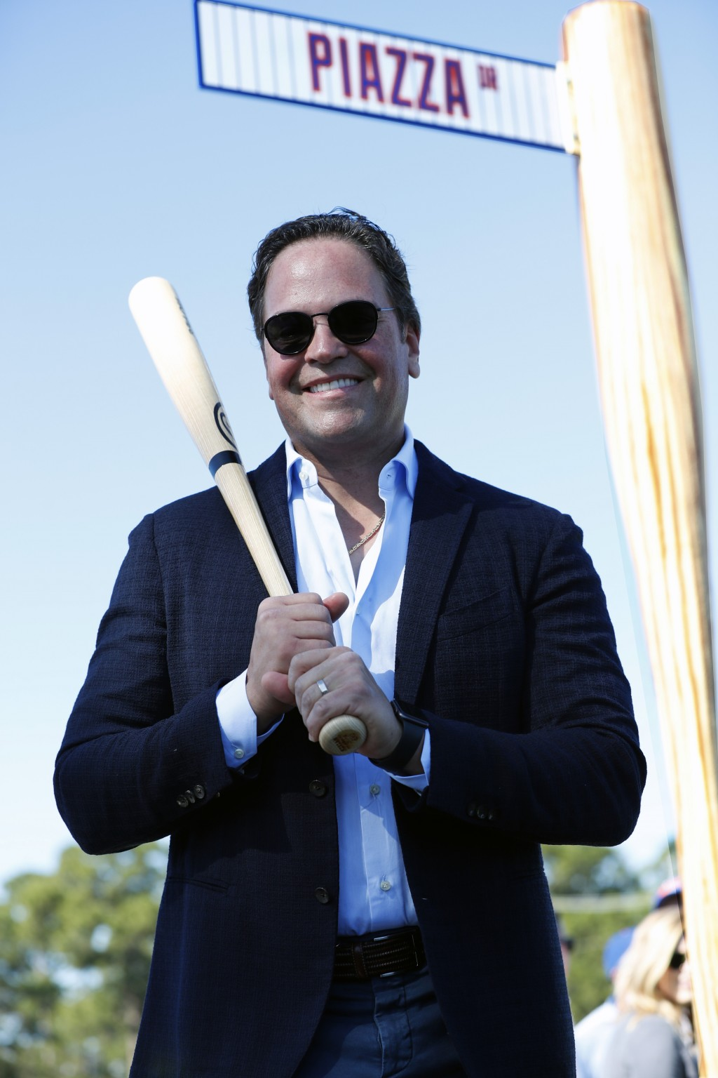 Former New York Mets catcher Mike Piazza poses for a photo under a street sign for newly named Piazza Dr., after a ceremony in front of the Mets sprin...