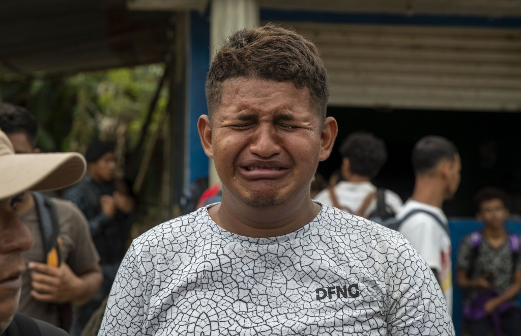 A teenage Honduran migrant traveling in a group of migrants cries as is he deported by Guatemalan police in Morales, Guatemala, Thursday, Jan. 16, 202...