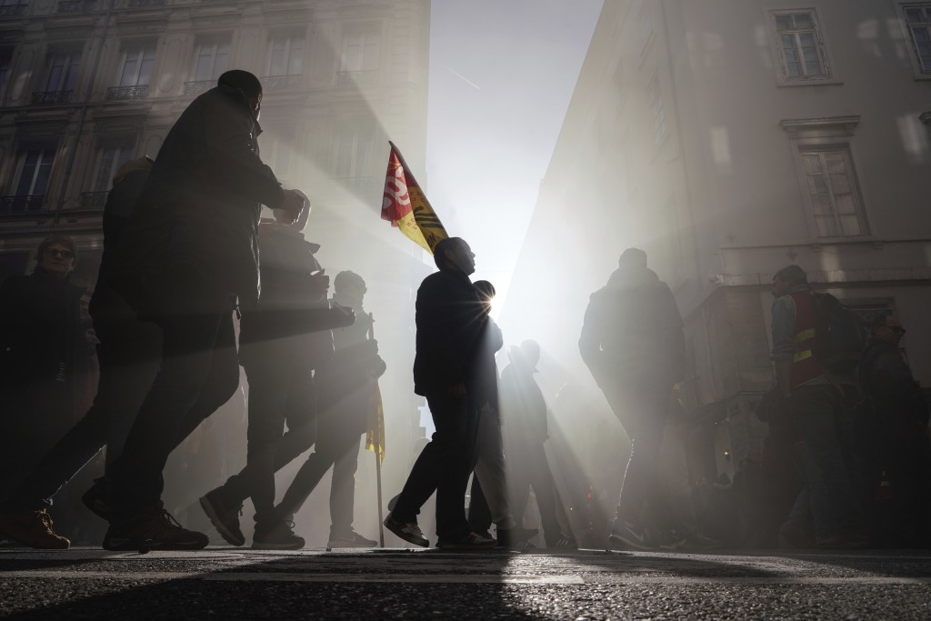 Protesters march during a demonstration in Lyon, central France, Thursday, Jan. 16, 2020. Protesters denounced French President Emmanuel Macron's plan...