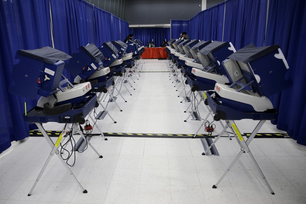 FILE - In this March 13, 2018, file photo, voters cast their ballots in Illinois primary elections at the city's new early voting super site in downto...