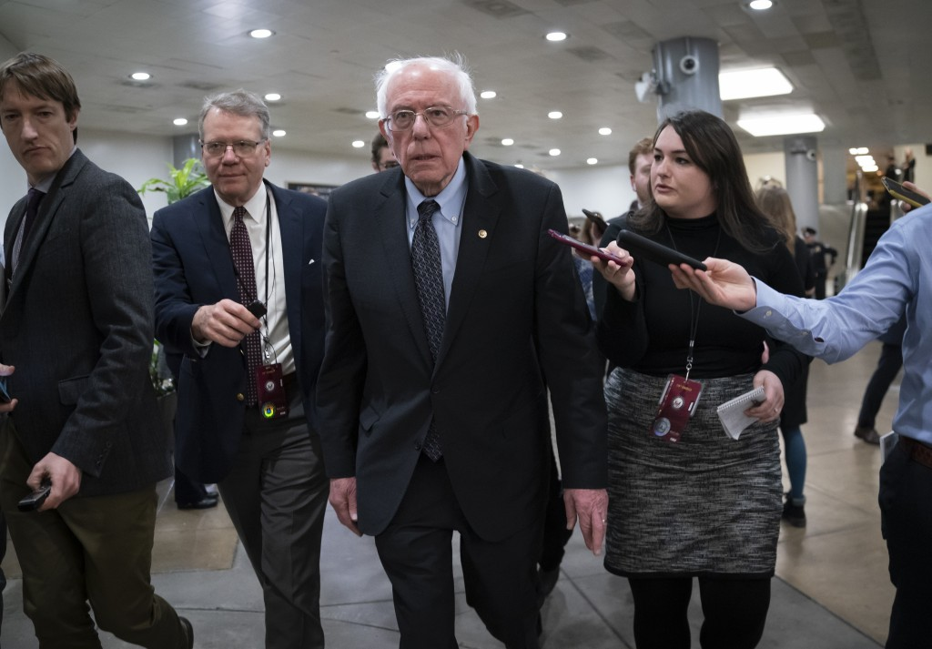 Democratic presidential candidate, Sen. Bernie Sanders, I-Vt., talks to reporters just after the start of the impeachment trial of President Donald Tr...