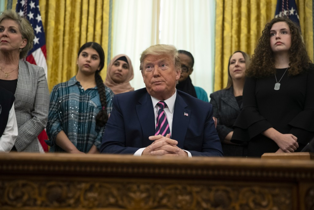 President Donald Trump listens to a question during an event on prayer in public schools, in the Oval Office of the White House, Thursday, Jan. 16, 20...